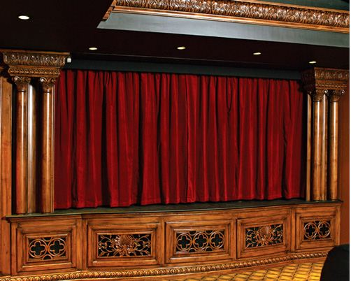 draper starts the movie with motorized theater curtains